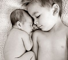 Aiden & Ainsley Photo Shoot- Snuggles  Get a cute picture of the siblings snuggling up together by laying your sleeping, curled up infant next to big brother or sister.
