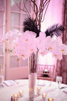 #orchids #feathers #centerpiece Photography by kristinvining.com Floral Design by careyrobertsdesign.com  Read more - http://www.stylemepretty.com/2012/06/06/charlotte-wedding-at-the-duke-mansion-by-kristin-vining-photography/