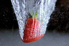 Strawberry in water (Lenny experimenting with high-speed photography. Bbc, High Speed Photography, Strawberry, Inspiration, Water, Photos, Hi Speed Photography, Learn Photography, Mandalas