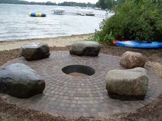 paver_firepit_with_big_boulder_outcroppings_used_for_sitting_around_camp_fire.jpg 800×600 pixels