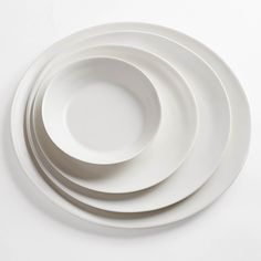 Inspired by the rippling tides of water, this collection embodies the organic simplicity of nature's most basic elements. Small Plate, Side Plate, Large Plate and Charger sold below.