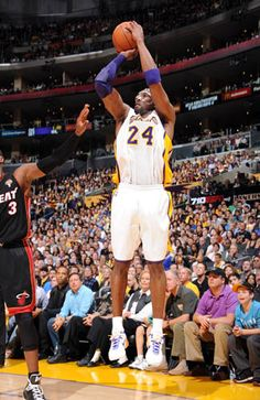 Kobe hits 2 of his 33 as the Lakers win their 8th straight at home 93-83 over the Heat