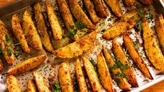 Baked Garlic and Parmesan Potato Wedges - Easy Meals with Video Recipes by Chef Joel Mielle - Potato Wedges Recipe, Potato Wedges Baked, Sweet Potato Wedges, Parmesan Garlic Potato Wedges, Parmesan Potatoes, Potato Dishes, Potato Recipes, Baked Garlic, Mediterranean Dishes
