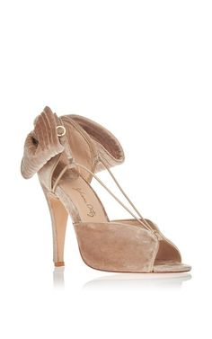 Presenting the much awaited debut of **Johanna Ortiz** x **Moda Operandi** shoes. Crafted in Colombia, each shoe reflects the designers signature flare and femininity. This Nude Eugene Sandal is rendered in velvet and features a large bow at the heel.