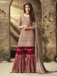 Exotic violet partywear sharara suit online which is crafted from georgette fabric with exclusive embroidery and hand work. This stunning designer sharara suit comes with georgette bottom and chiffon dupatta. Pakistani Dresses, Indian Dresses, Indian Outfits, Pakistani Bridal, Indian Clothes, Eid Clothes, Pakistani Sharara, Pakistani Clothing, Sharara Designs