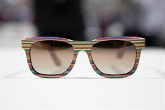 Multi-color horizontal striped wood frames. Paul Smith-esque. Recycled skateboard material.