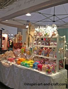 Bright handmade soap booth : once again all white background & colorful items for sale.  Love the fairylights on the table