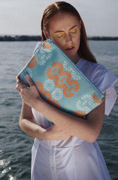 Twelve scuba clutch Hera pattern // waterproof fabric and lining  Model: Sophia Zachariadou Clothing: Lefkon Photographs: Iro Simaioforidou