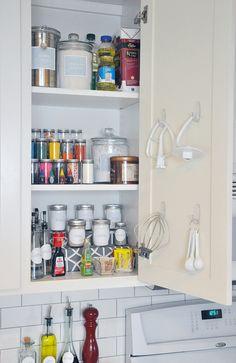 Mixer attachments hung inside a cupboard