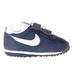 NIKE Elite Trainer Infant - Obsidian Blue / White. The Nike Elite Infant Kids Trainer is a retro fashion Shoe reborn with a nylon upper and midfoot straps for breathability and a snug fit. With a time-tested running profile that got its start in 1976 its a great sports fashion look for your children.