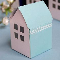 Blue House Favor Boxes Bridal Shower Party Favor Gift Container - 100 pcs   This exquisite favor box is a creative alternative to the classic box. White and colorful walls make a striking background for the lovely flower patterns on both sides. Fill it with candies or nuts, and its acetate widow will reveal the sweet secrete of your treats.  Each box is made of a single piece of sturdy and eco-friendly 350g craft paper. Ships flat and very easy to be folded.