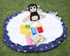 This Playmat is a great portable playmat that converts to a bag in seconds. It is perfect for quick storage of Lego, blocks, cars and toys that can be swept onto the mat and packed up by pulling the two cord toggles to transform the playmat into a bag. #finleeandme #playmat