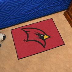 """Saginaw Valley State Starter Rug 20x30 - Decorate your home or office with area rugs by FANMATS. Made in U.S.A. 100% nylon carpet and non-skid recycled vinyl backing. Officially licensed and chromojet printed in true team colors.FANMATS Series: STARTERTeam Series: Saginaw Valley State UniversityProduct Dimensions: 19""""x30""""Shipping Dimensions: 30""""x19""""x0.25"""". Gifts > Licensed Gifts > Ncaa > All Colleges > Saginaw Valley State University. Weight: 1.80"""