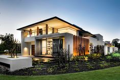 COOLBINIA RESIDENCE 2, Built on a spacious corner block, the home boats three striking elevations from side to front. Large timber columns