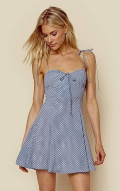 """Blue Life's brand new Sienna Corset Dress features a dainty polka dot print throughout, sweetheart bust with tie detail, ruched back, and over the shoulder tie straps. Made in USADry Clean Only100% RayonFit Guide:Model is 5ft 10 inches; Bust: 32"""", Waist: 24"""", Hips: 34""""Model is wearing a size SRelaxed Fit"""
