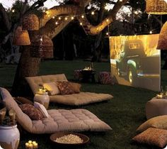 http://lovinglivingsmall.com/blog/home/design-inspiration/summer-treat-a-backyard-movie-theater/