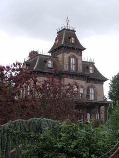 At Disneyland Paris, the Haunted Mansion goes by the name Phantom Manor and looks very different from its counterparts in other countries. It looks, at first glance, to be more reminiscent of the house in Hitchcock's Psycho. Photo Source: Walt Disney Paris