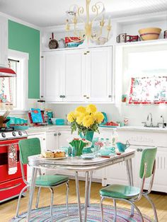 Love the red stove and the vintage table and chairs!!