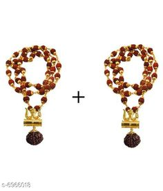 Pendants & Lockets Moksh Shiv Trishul Damaru Locket Rudraksh stylish Mala pack of 2 Base Metal: Brass Plating: Gold Plated Stone Type: Rudrakshi Type: Pendant with Chain Multipack: 2 Sizes: Country of Origin: India Sizes Available: Free Size   Catalog Rating: ★4.2 (439)  Catalog Name: Shimmering Charming Pendants & Lockets CatalogID_1112307 C77-SC1095 Code: 512-6966018-9941