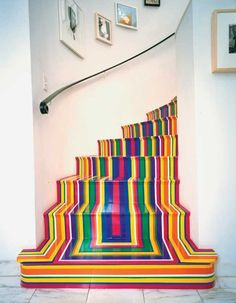 Colorful DIY striped stairs with vinyl tape.