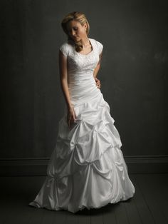 Description: A-line ball gown features a beaded embroidered  bodice with an asymmetrical ruched waistline. The ball gown skirt is  designed with soft, caught-up details, a bubble hem, and chapel length  train. A line silhouette. Nice modest gown to be chosen for formal  weddings.   Fabric: ...