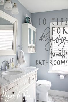 White marble vanity and soft blue-grey walls