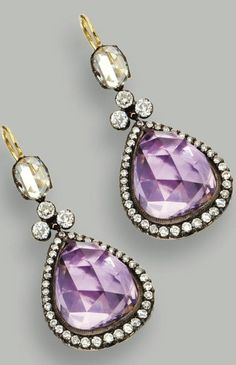 PAIR OF AMETHYST AND DIAMOND PENDANT-EARRINGS Set with 2 pear-shaped rose-cut amethysts measuring approximately 16.5 by 13.5 by 8.5 mm., framed by small round diamonds, surmounted by 6 round and 2 oval rose-cut diamonds, the total diamond weight approximately 4.50 carats, mounted in gold and silver.