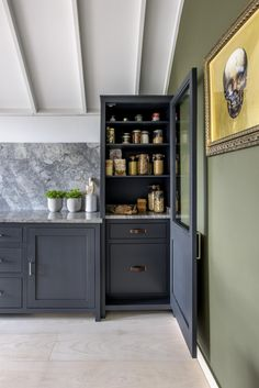 This larder with a stylish, tailored home for all of your cooking essentials in this kitchen by Middleton | modern kitchens| www.middleton-bespoke.co.uk