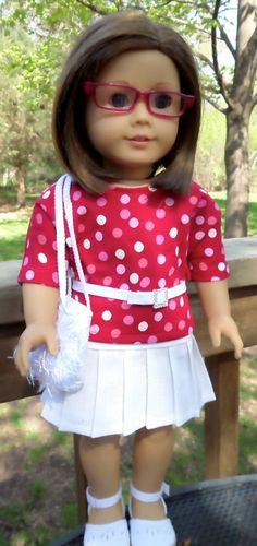 Polka dot top and white pleated skirt by buttonandbowboutique on Etsy.  This outfit is made using the Liberty Jane Clothing Pleated Skirt pattern. Find the Pleated Skirt pattern at http://www.pixiefaire.com/products/pleated-skirt-18-doll-clothes. #pixiefaire  #libertyjane  #pleatedskirt