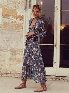 Santa Rosa Maxi   Floral printed silk maxi dress featuring a V-neckline with tassel accent. Soft pleating along the placket and ruffled hem. Sheer sleeves with drawstring closure at the cuffs. Dropped waist and a shapeless, effortless silhouette. Lined.