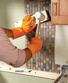 Installing tile backsplash…i'll need this one day :) @ Home Improvement Ideas