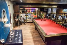 Game room at SLO Brew. Located in the heart of downtown San Luis Obispo, CA - SLO Brew is a neighborhood local brewery, restaurant, event space and music venue featuring a full bar, billards lounge and creekside patio dining. Central Coast, California.