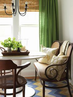 Simply Sophisticated...Furniture pieces with graceful curves and lines set a sophisticated tone. Kelly green linen curtains enhance the refined room. White pillows with green patterns dress it up and add flair.