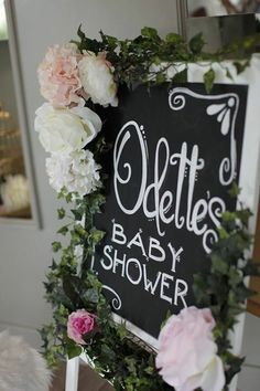 This is how Odette's Swan Princess baby Shower turned out.  We bought the kids painting board at ikea, painted it white and just decorated it with fake flowers. We had to paint the board with black chalkboard paint as it has a white board side. Aimee Brenes