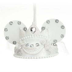 Hang Minnie's glittering, gem-studded tiara and veil ear hat ornament on the holiday tree or save it to celebrate that special day. Find an ear-ternal soulmate in Mickey's groom hat ornament, sold separately.