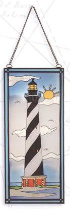 """Black/White Lighthouse Nautical Stained Glass Window Decoration by HS. $32.95. It makes a great gift, impressive decoration and will be admired by all those who love the sea.. This item features a beautiful black & white lighthouse scene with the sun in the background.. The black/white lighthouse stained glass measures 17.5"""" x 7.5"""".. It will add a definite nautical touch to wherever it is placed and is a must have for those who appreciate high quality nautical decor.. The blac..."""