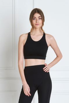 Lydia Sports Bra - Slip into the silky soft Lydia Sports Bra, artfully designed to accentuate the female silhouette. Internal padding and soft jersey lining offer medium support perfect for Yoga, pilates, cycling and walking. The non-toxic materials are finished with tailored piping on the front, back, neckline and armholes, and a reverse side logo. Complete the look with the matching Giselle legging.