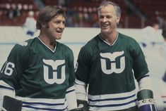 Gordie Howe (9) and Bobby Hull (16) of the Hartford Whalers look on against the Montreal Canadiens at the Forum