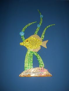 yellow tang fish wall art sculpture done in rhinestones with a protruding base with LED light attached