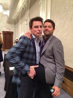 John Barrowman and Misha Collins. When i met John Barrowman at Comic Con, he did that exact same pose with me for our picture!! I almost died. Especially since it was his own doing