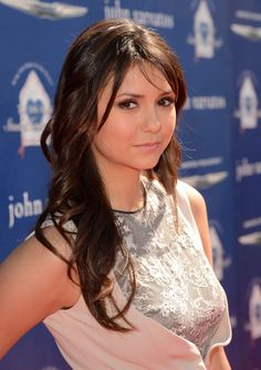 Nina Dobrev Long Curls with Bangs - Nina Dobrev showed off her signature chocolate locks with these long curls with side-swept bangs.