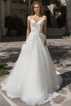 Glamorous Tulle Bateau Neckline See-through Bodice A-Line Wedding Dress With Beaded Lace Appliques