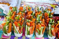 Veggie Cups! Put dip in the bottom of a clear plastic cup and place a variety of veggie strips inside. #Easy #healthysnack