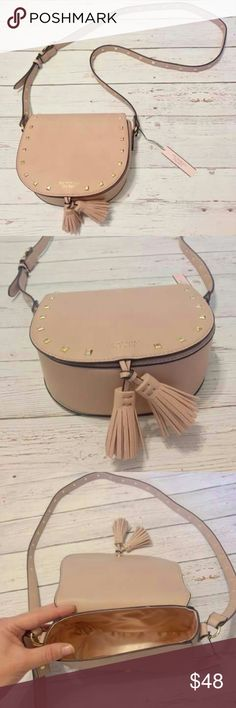 "NWT Victoria's Secret Pink Studded Handbag NEW 2017 Limited Edition Victoria's Secret Pale Pink Faux Leather Studded Festival Tassle Bag! Has 22"" Adjustable Crossbody Strap.Very Girly and Chic. Never Used, with Tags! Victoria's Secret Bags Crossbody Bags"