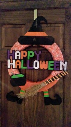 Learn how to make a witch Halloween wreath with perler creations!