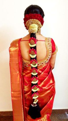 South Indian bride. Temple jewelry. Red Kanchipuram silk sari.Braid with fresh flowers. Tamil bride. Telugu bride. Kannada bride. Hindu bride. Malayalee bride.