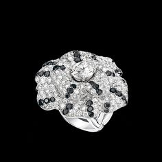 CHANEL - Camélia Ring in 18K white gold, black diamonds and diamonds.