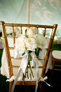 bridal bouquet on the back of her chair during reception, or nosegay for each chair