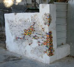 Urbanation - A cool new trend in street art: Lego bombing. Artists worldwide are filling in the holes of crumbling streets, walls and buildings with Legobricks
