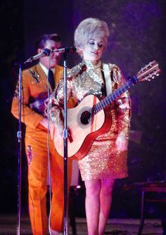 Dolly Parton in a beautiful sparkly gold dress